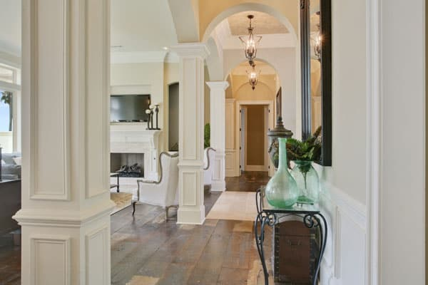 The opposite side of the corridor shows the ornate console table and living room.