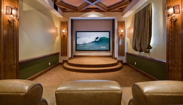Home theater with leather recliners and a two-step podium by the screen.