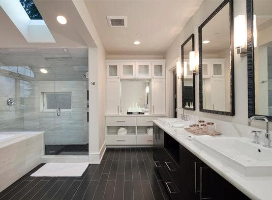 Side view of the primary bathroom shows the built-ins and a skylight that brings natural light in.