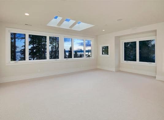 Spacious bonus room with plenty of windows and skylights inviting an abundance of natural light in.