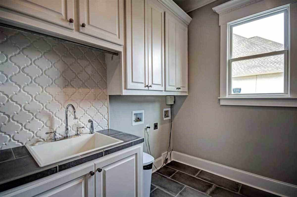 The opposite side view shows the porcelain sink fixed under the white patterned backsplash.