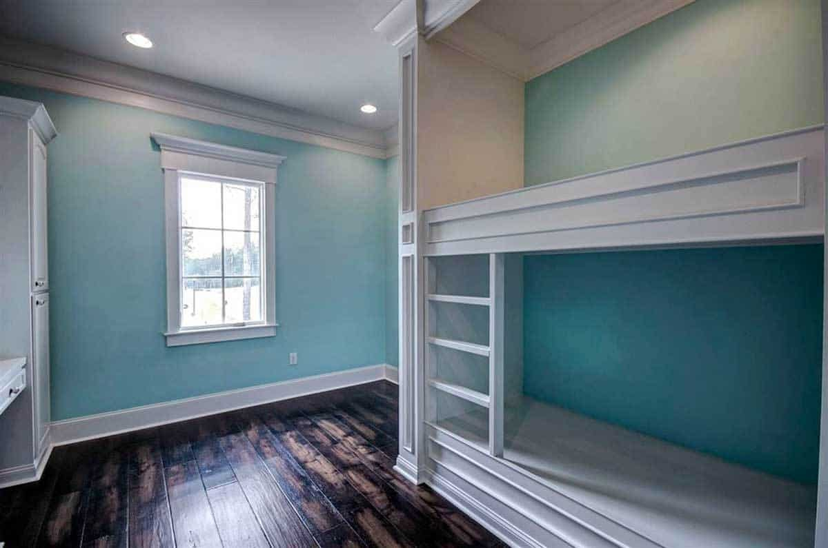 This bedroom offers a built-in bunk bed fixed against the blue walls.This bedroom offers a built-in bunk bed fixed against the blue walls.