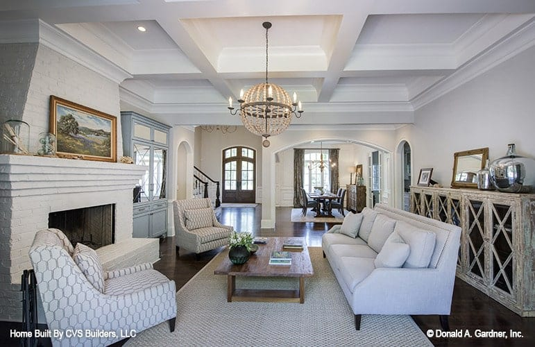 A Gray sectional sofa and a rustic coffee table under the spherical chandelier completed the living room.