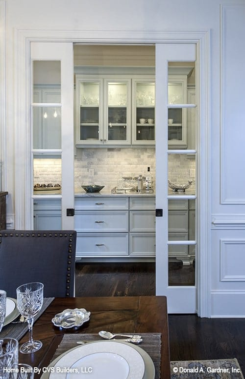 Across the dining area is the butler's pantry accessible via the sliding glass doors.