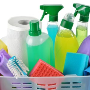 A basket that is filled with various cleaning materials and products.