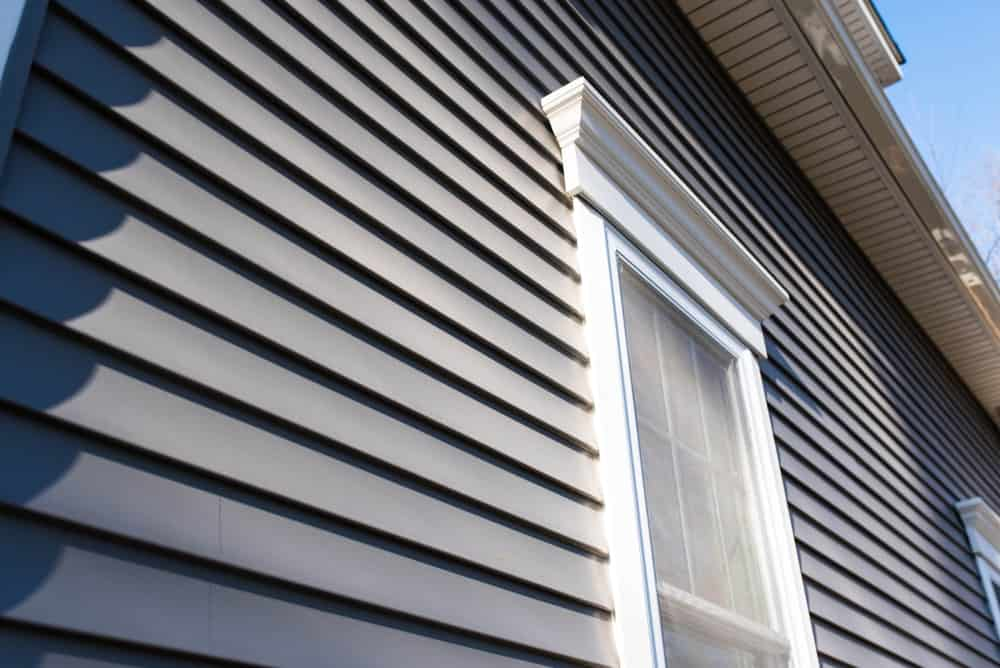 Closeup of a home's exterior vinyl siding.