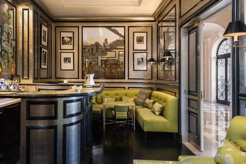 This charming and luxurious area is the bar of the estate with dark wooden elements to the bar and the walls that make the cushioned built in curved bench stand out with its green tone. Images courtesy of Toptenrealestatedeals.com.