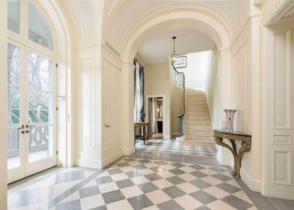 Upon entry of the arched main door, you will be welcomed by this grand bright foyer with gray and white checkered marble flooring to pair with the beige walls and arched entryways. Images courtesy of Toptenrealestatedeals.com.