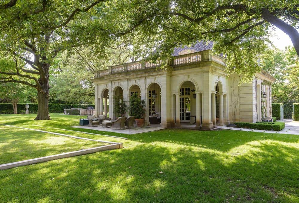 This is a closer look at the back of the house that has rows of elegant tall archways that complement the beige exterior walls. Images courtesy of Toptenrealestatedeals.com.