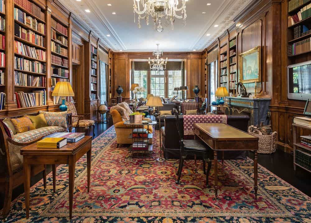 This is the library of the house with tall built-in bookshelves on the walls surrounding a sofa set that is warmed by a fireplace for a perfect reading area. Images courtesy of Toptenrealestatedeals.com.