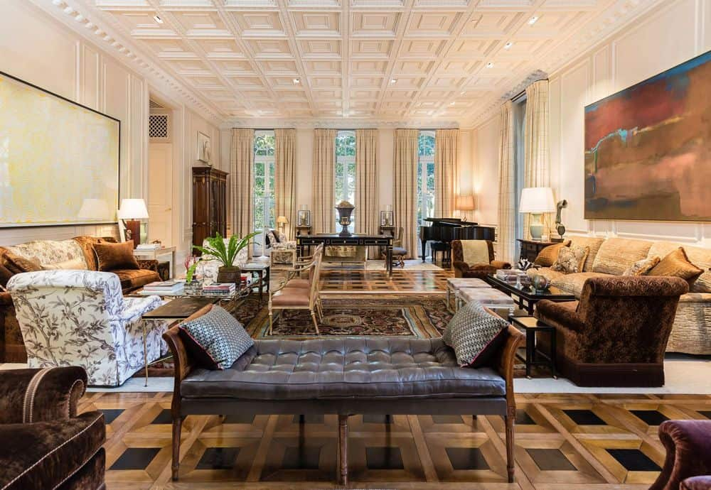 This is the formal living room with agrand air of elegance and luxury to its tall coffered ceiling and even a grand piano at the far end by the tall row of windows. Images courtesy of Toptenrealestatedeals.com.