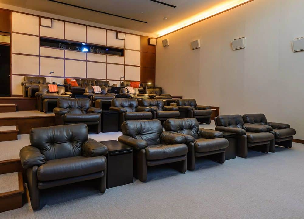 This is the gorgeous home theater with comfortable black leather chairs placed in elevated platforms for an unobstructed view of the large screen. Images courtesy of Toptenrealestatedeals.com.