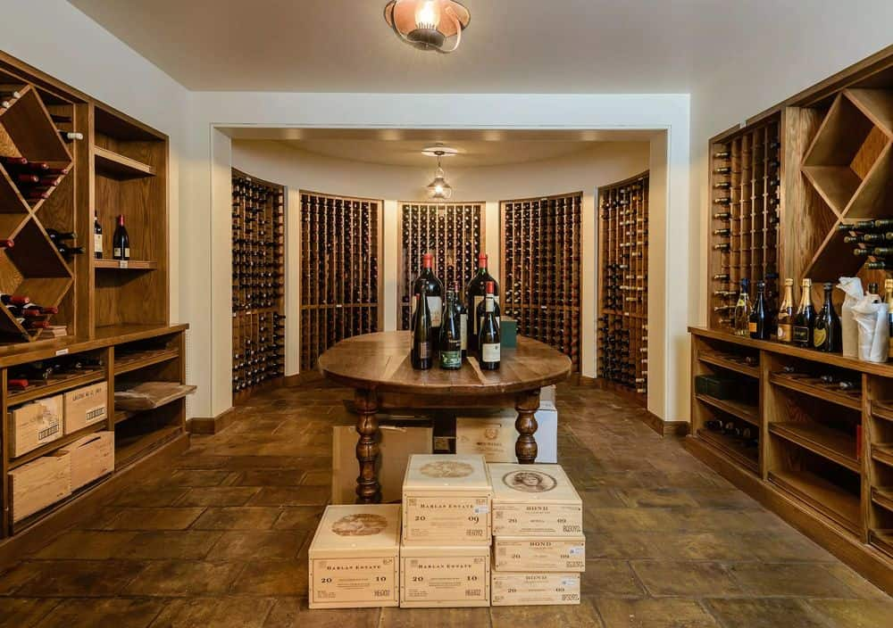 This is the luxurious wine cellar with the walls dominated by wooden structures for wine storage. In the middle sits a wooden table for wine tasting. Images courtesy of Toptenrealestatedeals.com.