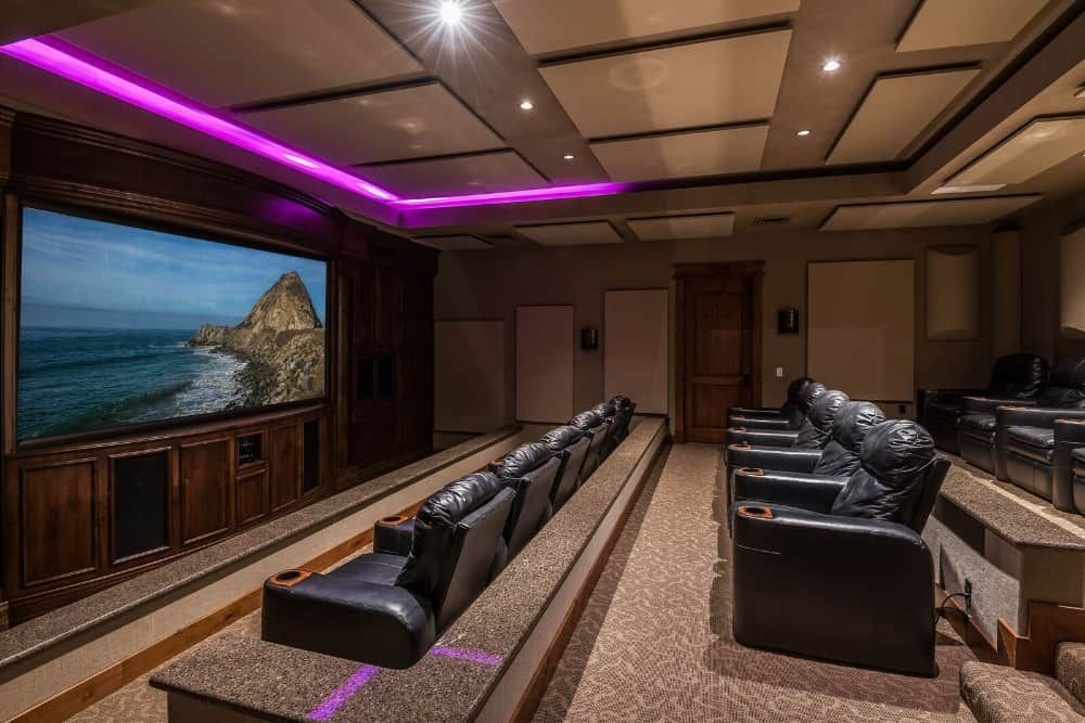 Large home theater boasting a flat-screen theater-style TV along with black leather sectional theater seats. Images courtesy of Toptenrealestatedeals.com.