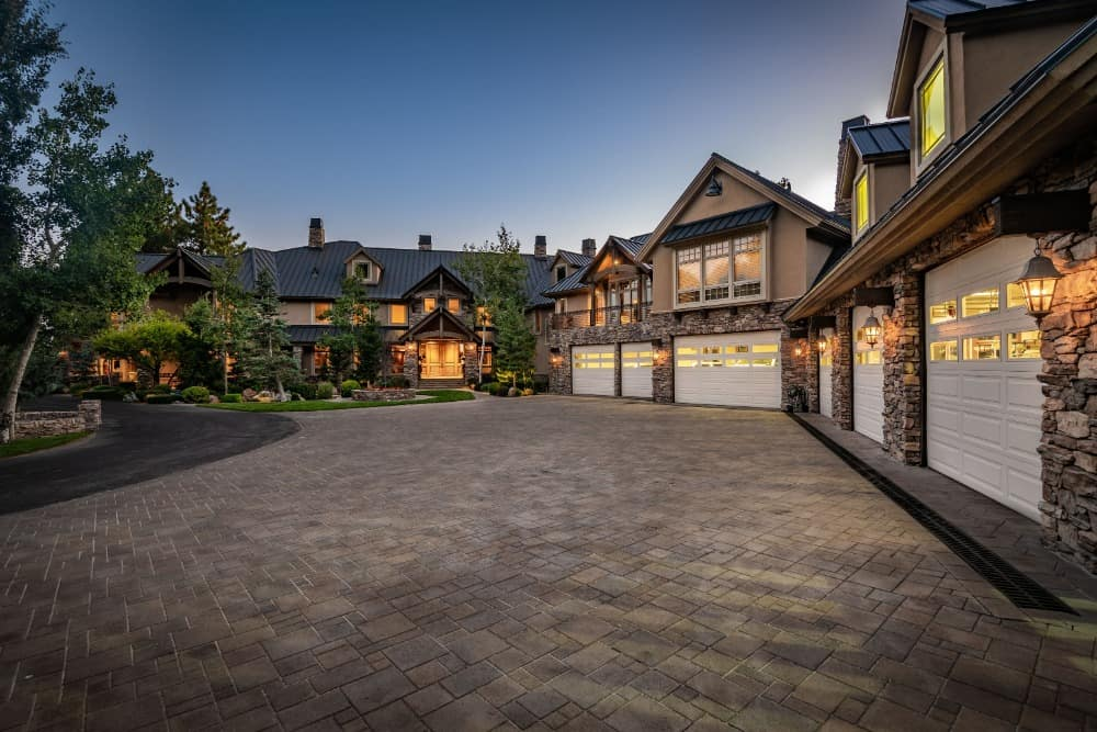 Here's the massive six-bay car garage and its wide driveway. Images courtesy of Toptenrealestatedeals.com.