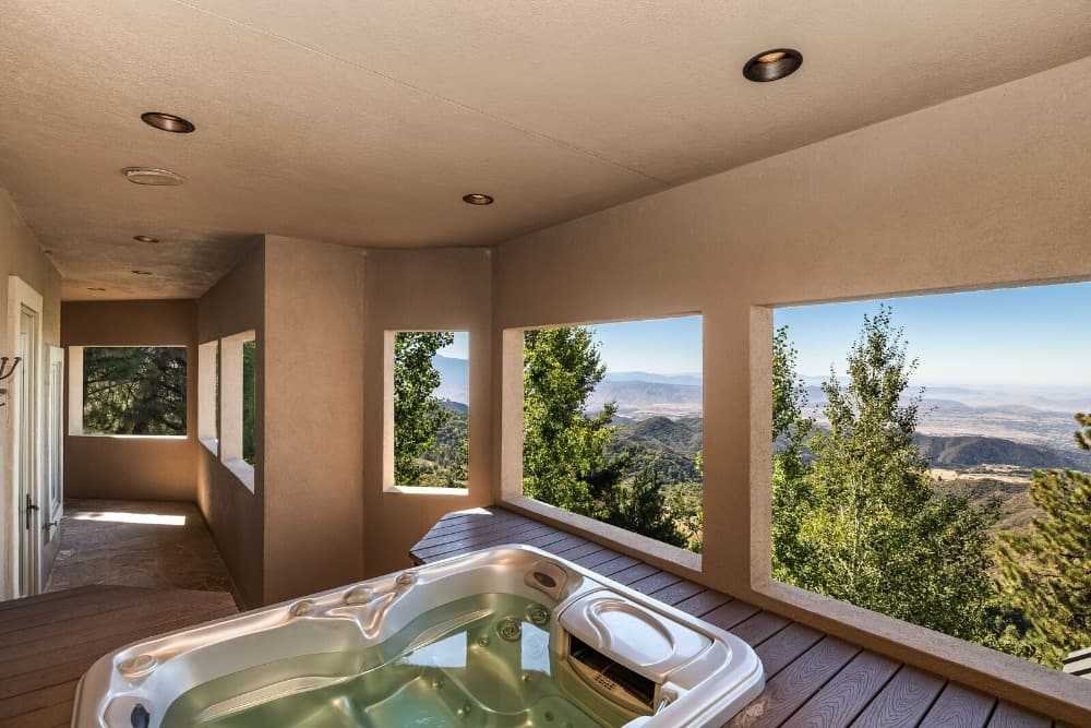 This drop-in deep soaking tub is situated near the home's sauna room. Images courtesy of Toptenrealestatedeals.com.