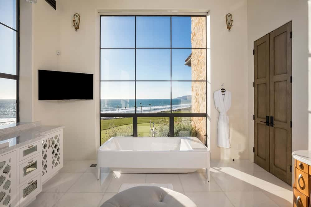 This bathroom also has a freestanding porcelain bathtub placed under a large window that gives a beautiful background as well as serve as natural light source. Images courtesy of Toptenrealestatedeals.com.