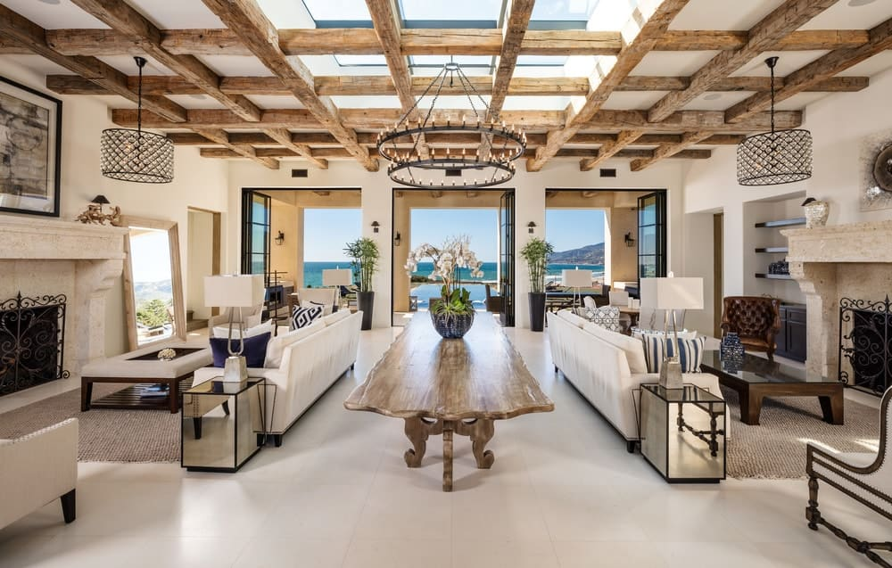 This is a large great room that houses two living room areas all under the large ceiling with exposed wooden beams and large sky lights. Images courtesy of Toptenrealestatedeals.com.