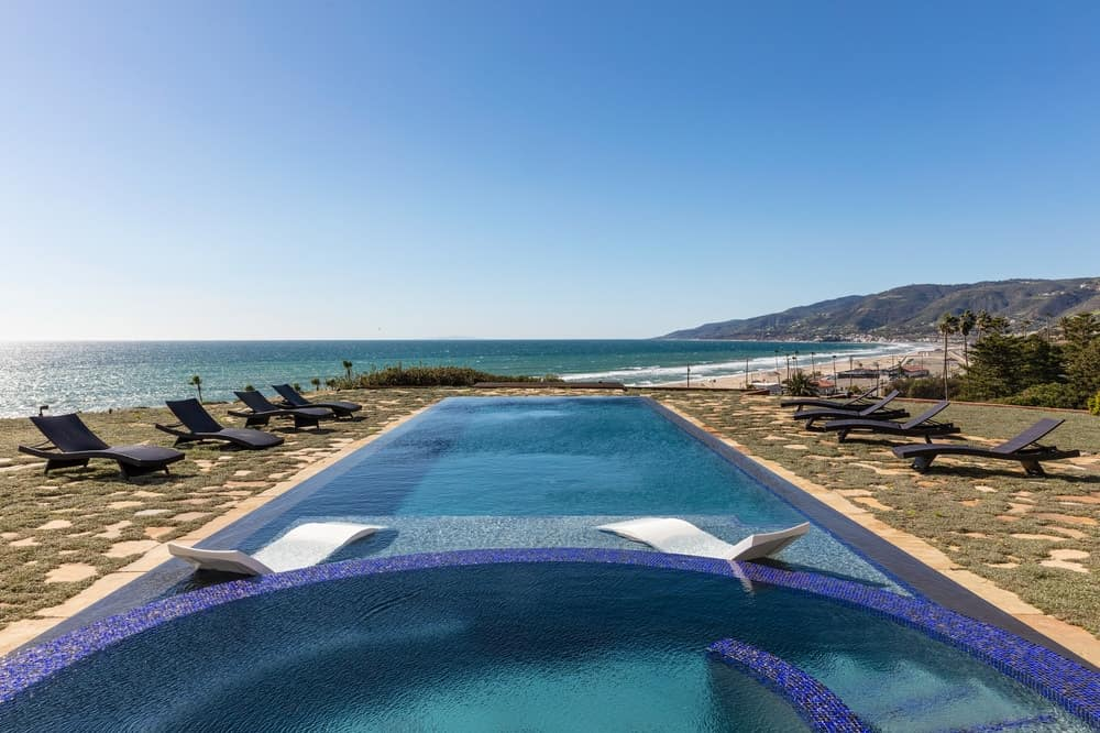 The view from the poolside area is simply breathtaking. It has a sweeping scenic view of the beach below with an unobstructed vision of the horizon in the far distance. Images courtesy of Toptenrealestatedeals.com.