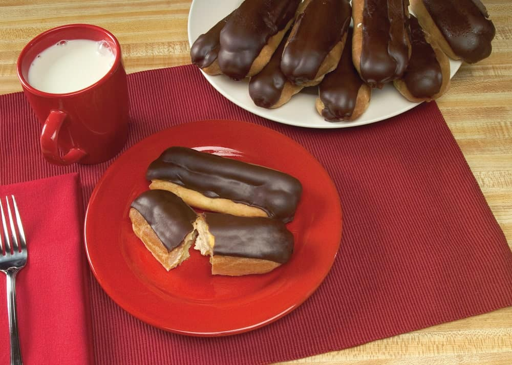 Long John donuts with a glass of milk