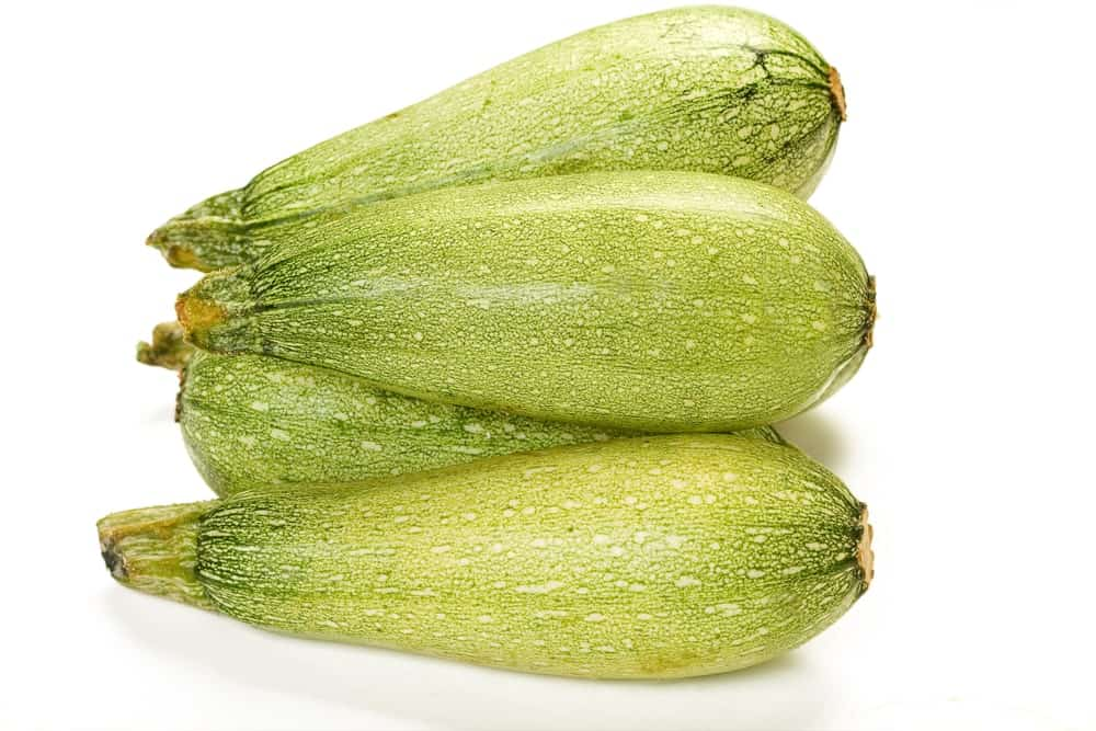 Four pieces of magda zucchinis on a white background.