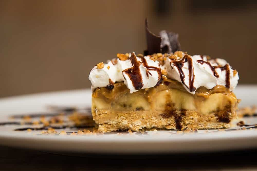 A close look at a slice of banoffee pie.