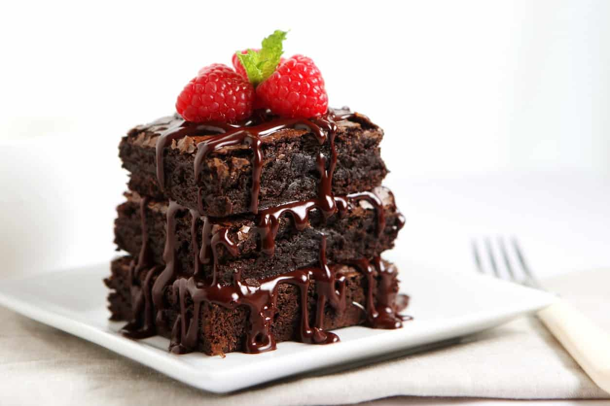 Frosted fudge brownies with chocolate syrup