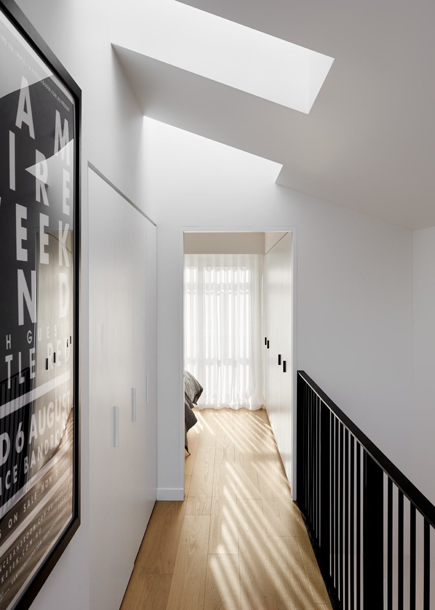 On the other end of this balcony entrance bedroom area. This hallway that leads to it has lovely black railings for the indoor balcony.