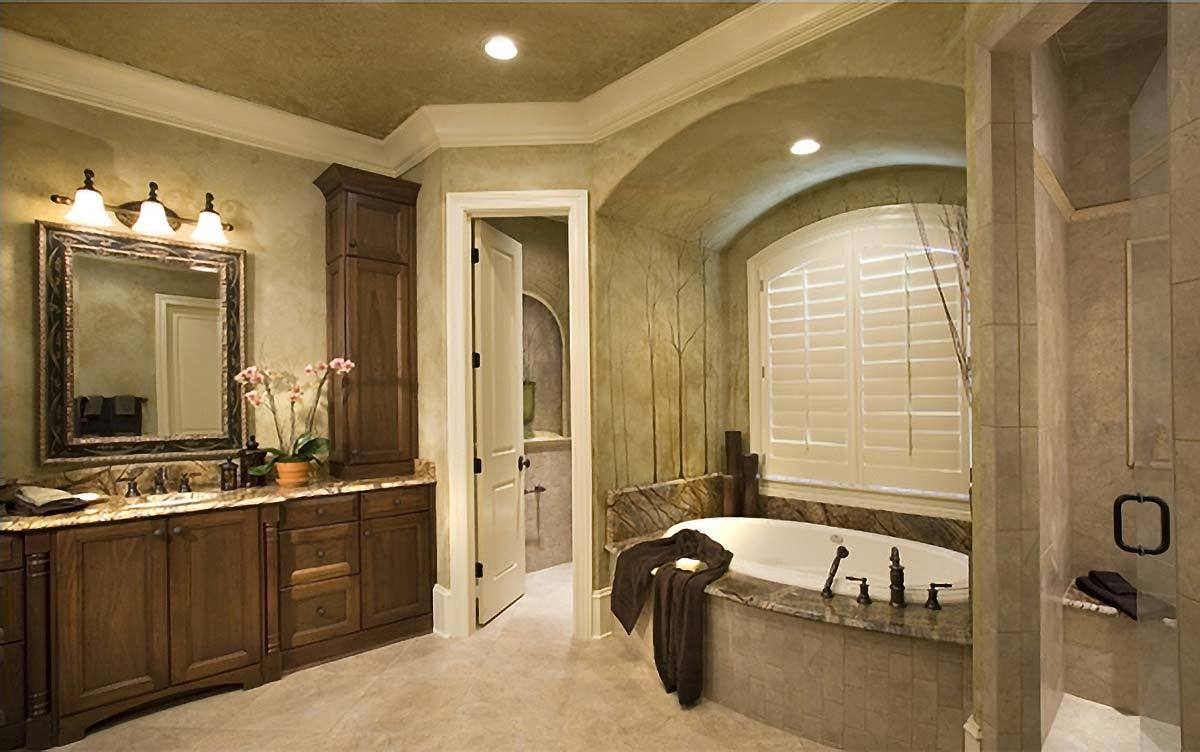 Primary bathroom with walk-in shower, a granite top sink vanity, and an alcove tub fixed under the white louvered window.