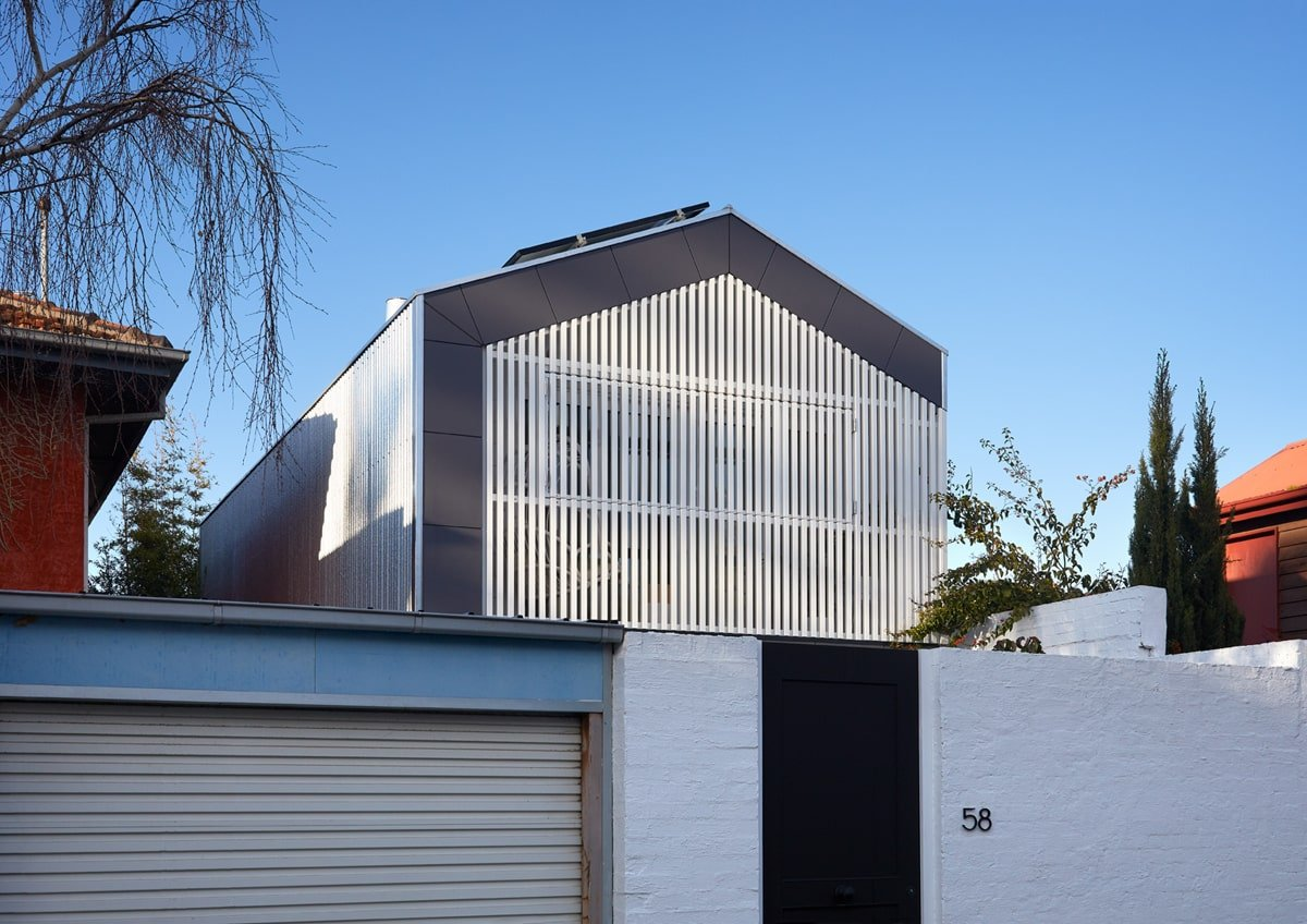 This view of the back of the house shows the lovely bright white aesthetic contrasted by the dark exterior wall panels of the second level of the house.