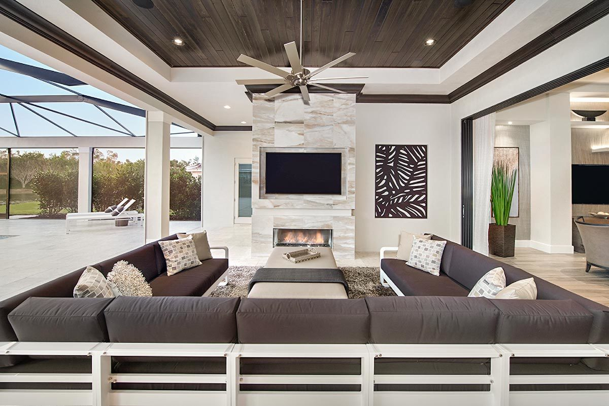 The outdoor living has a huge U-shaped sectional facing the TV and fireplace fitted in the marble pillar.