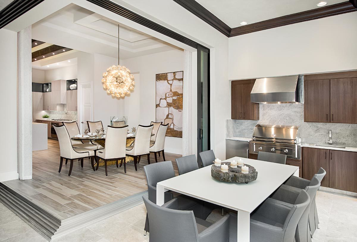 The dining room sits on a wood plank podium well-lit by a round glass pendant.