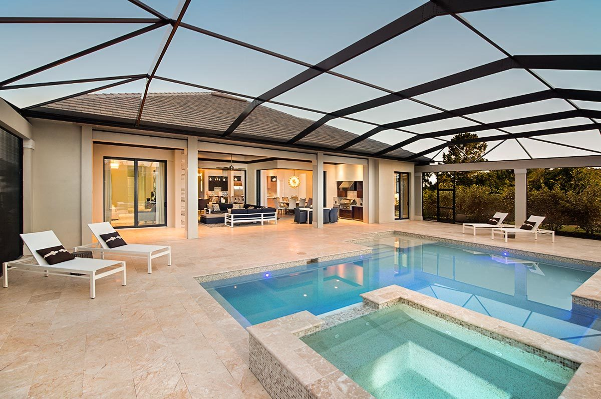 Covered patio with summer kitchen, outdoor living, and a stunning pool integrated with a relaxing spa.