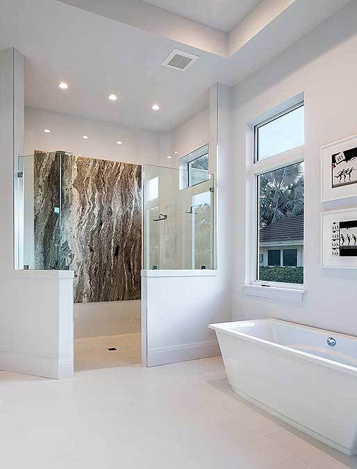 Primary bathroom with a freestanding tub and a walk-in shower equipped with two showerheads.