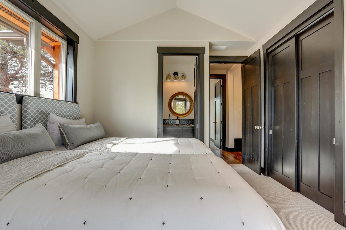 This bedroom offers two beds, a built-in wardrobe, and a private bath.