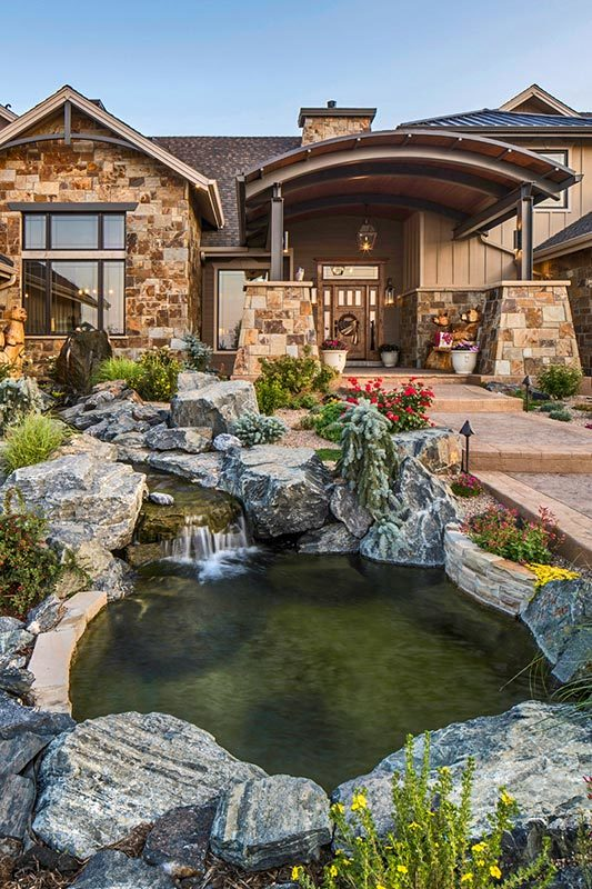 There's an enchanting pond on the side that adds to the home's appeal.