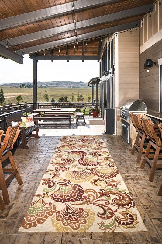 The covered deck consists of outdoor living and dining along with a summer kitchen.