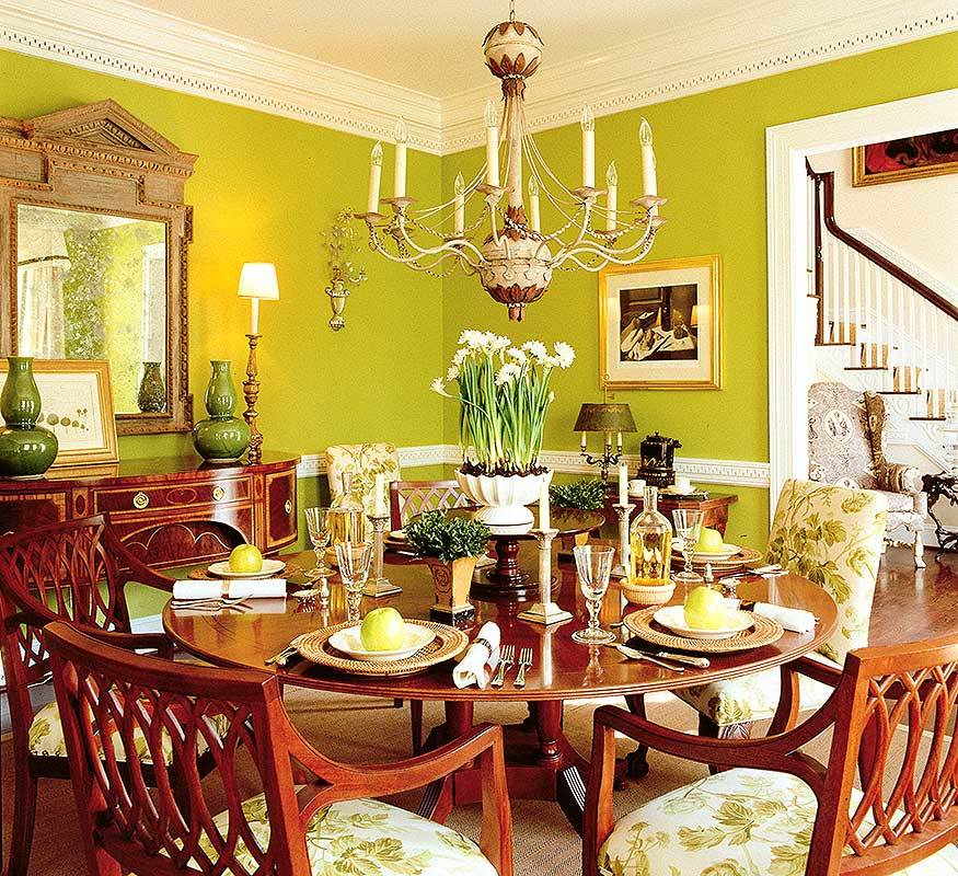 Formal dining room with a dark wood buffet table and a round dining set lit by a gorgeous candle chandelier.