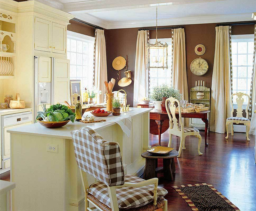 The kitchen has cream cabinetry and a matching breakfast bar contrasted with brown walls and hardwood flooring.