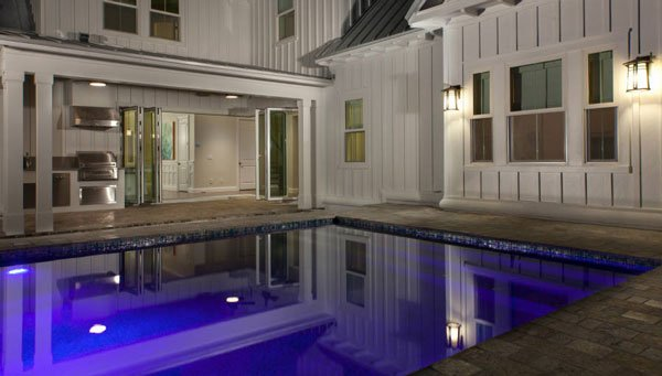 A closer look at the backyard pool highlighted with stunning lights that made it stand out at night.