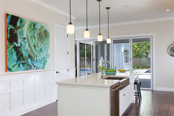 Glass doors across the kitchen island lead to the covered porch.