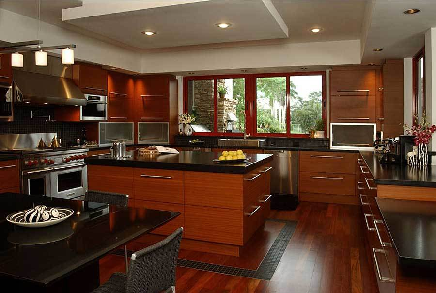 Redwood elements run throughout the eat-in kitchen. It has stainless steel appliances and a large center island sitting under the suspended ceiling.