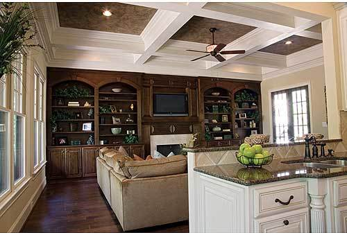 Behind the living room is the kitchen separated by a two-tier peninsula.
