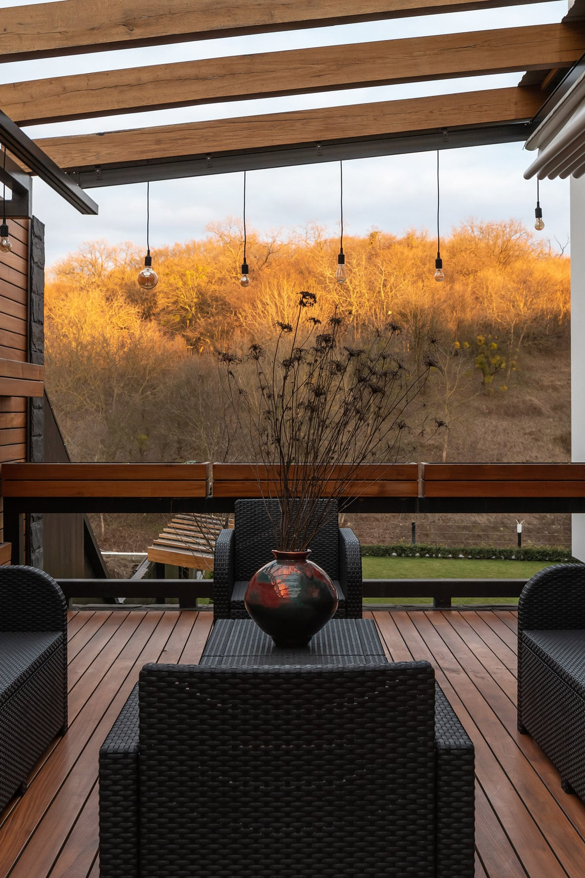This patio area has a great view of the landscape. You can also see here a grass lawn at a lower level that the patio.