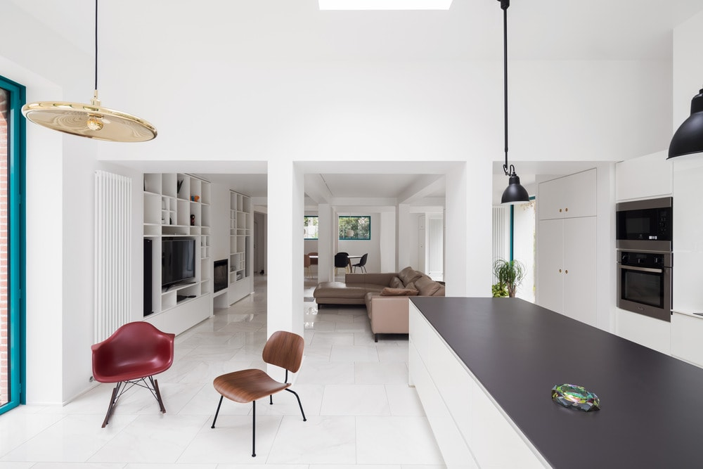 This angle look from the vantage of the kitchen island reveals the simple yet lovely living room beside it.