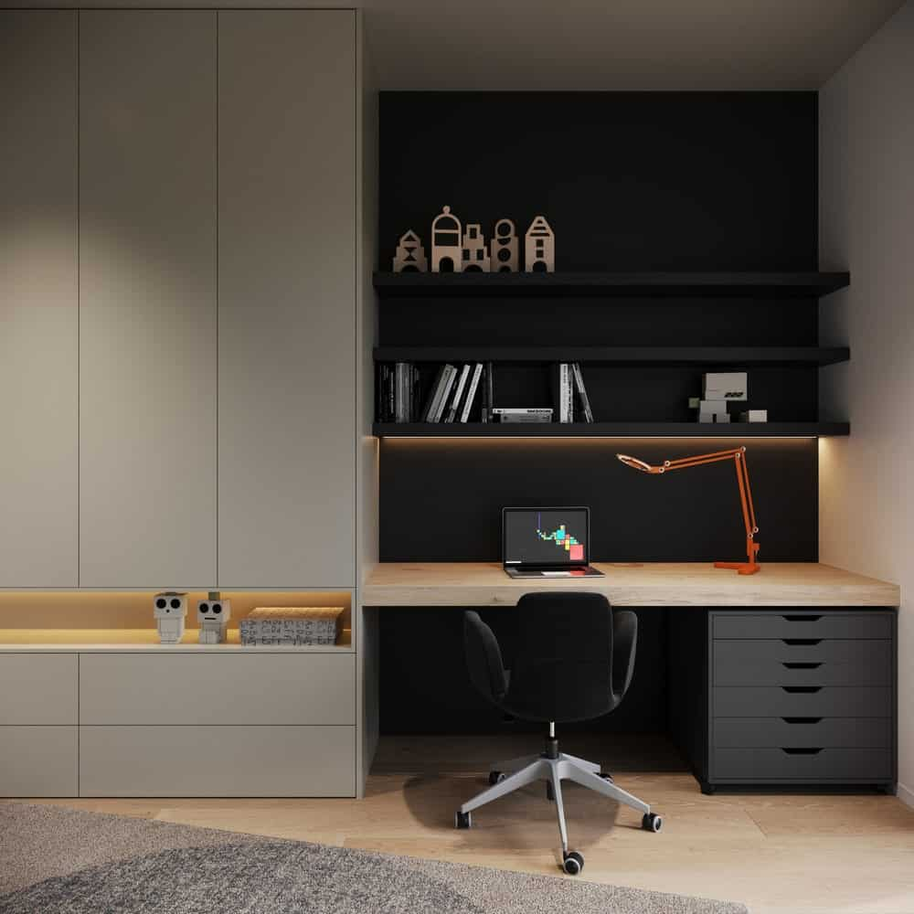 This is a close look at the home office that has a gorgeous black work station contrasted by the thick wooden desk surface and the white wall that matches well with the modern cabinetry.