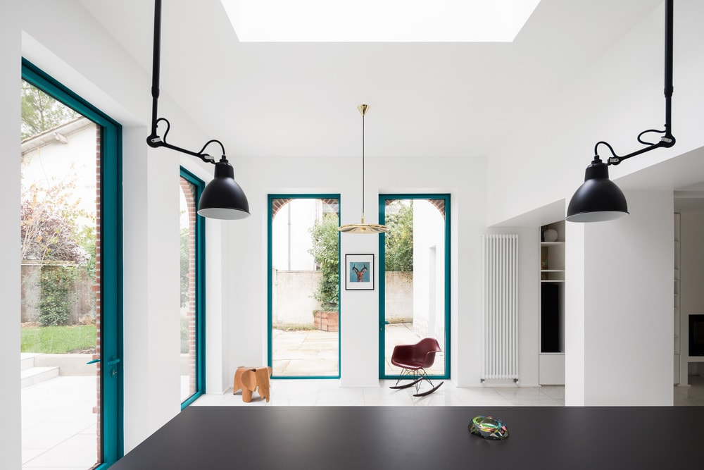 This is a look at the spacious area beside the kitchen that can be fitted with an informal dining area with a pendant light perfect for a small round table by the tall windows.