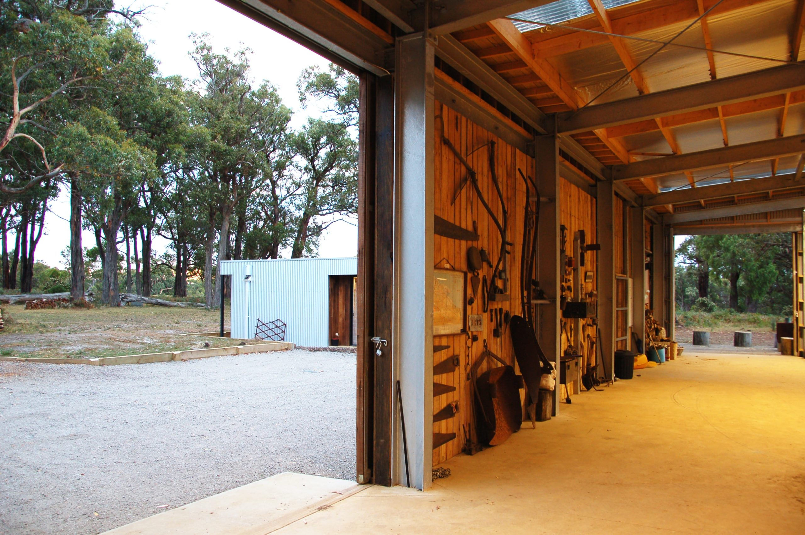 Just inside the large shed and garage is a large wall perfect for storage of various tools.Here you can also see the large metal beams that support the large structure.