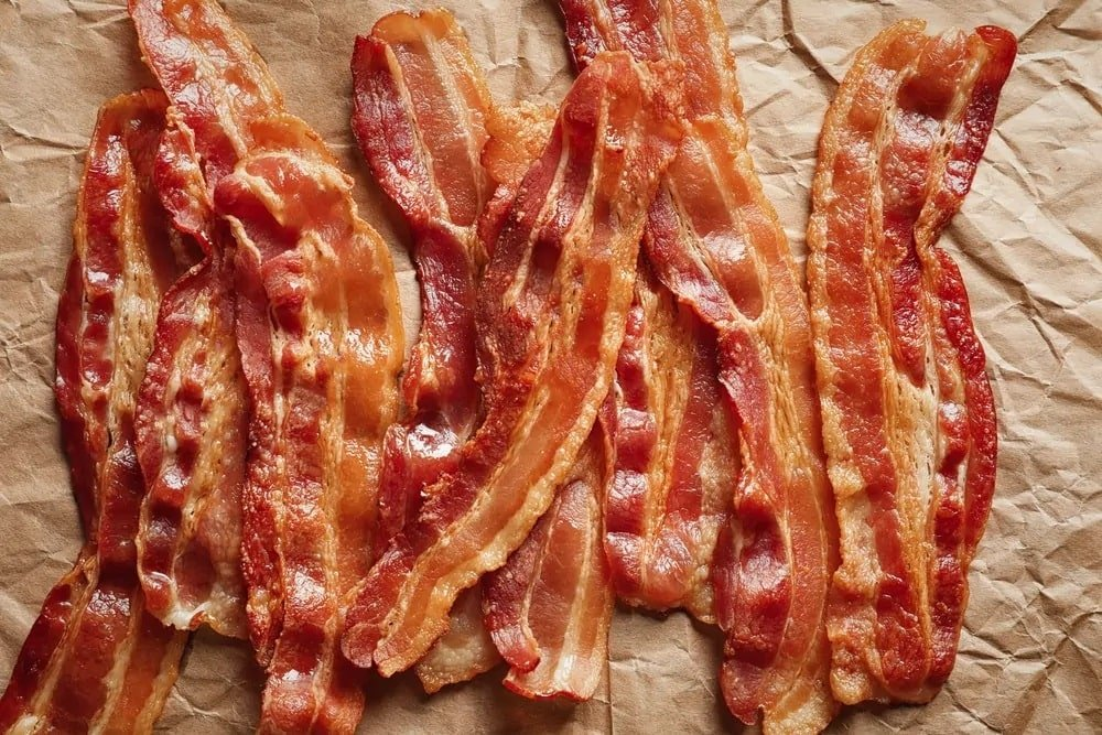 Strips of Bacon on a sheet of Kraft paper.