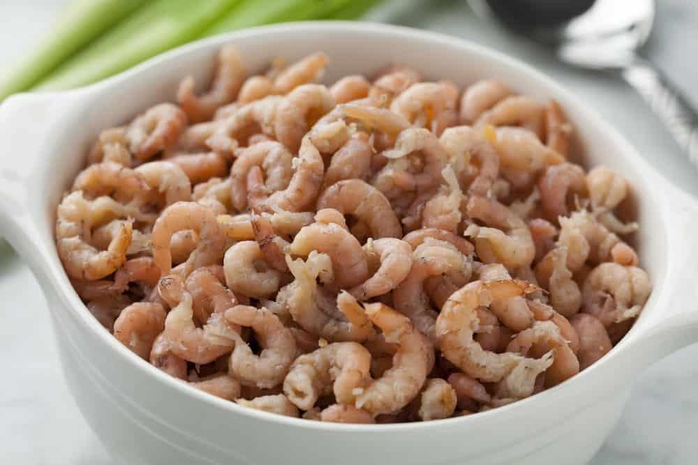 A bowl of brown shrimps.